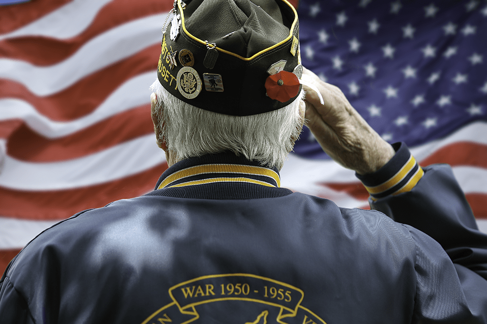 Korean War Senior Veteran Saluting Flag