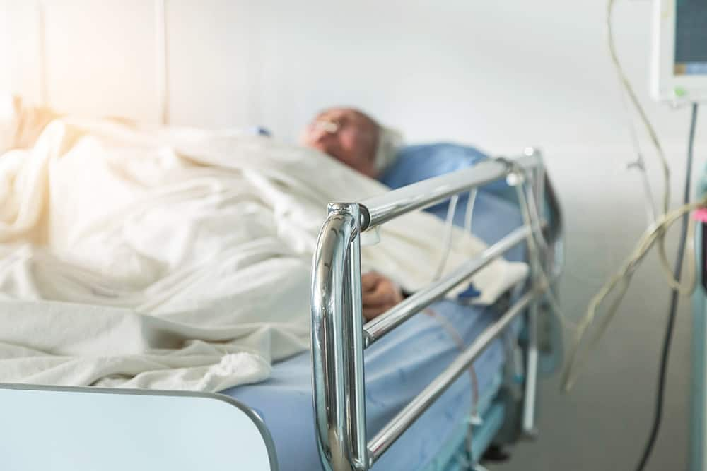 person in hospital bed needs advanced directive for healthcare